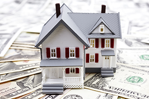 model of the house and us dollars , selective focus, finance or rental concept